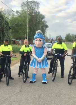 Police officers with mascot